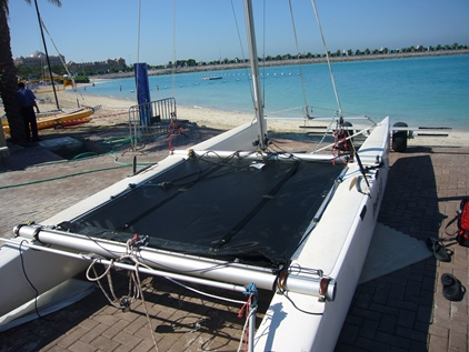 nacra 5.8 bias cut trampoline sitting on the beach